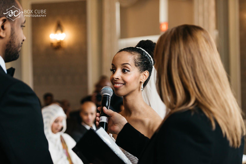 bride saying vows during wedding ceremony at hotel fairmont macdonald edmonton