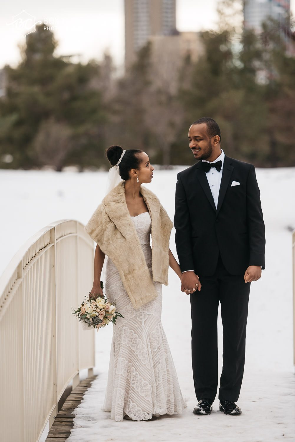 creative formal wedding portraits at muttart conservatory where bride and groom are holding hands