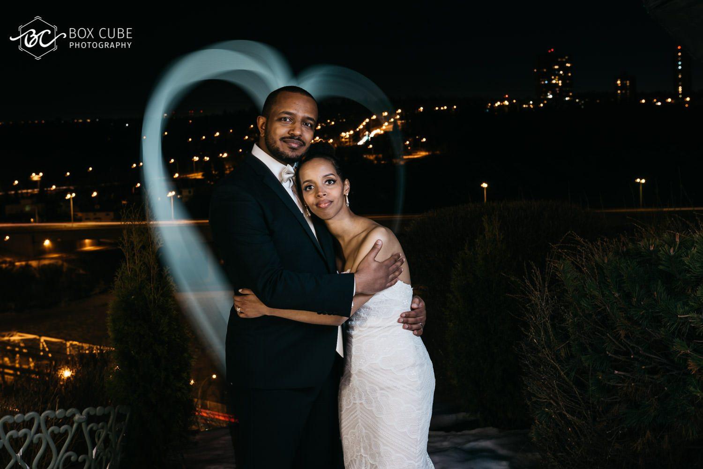 photo of bride and groom overlooking edmonton downtown from hotel fairmont macdonald balcony