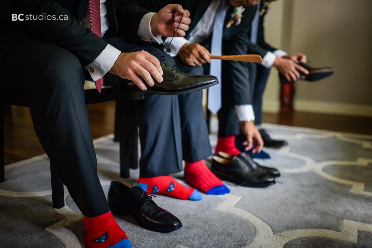 wedding at edmonton oilfield technical society. Groom getting ready. colorful socks.