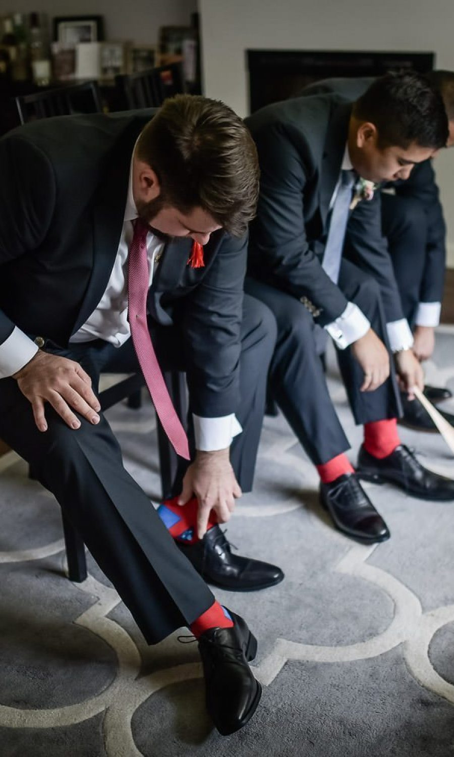 wedding at edmonton oilfield technical society. Groom getting ready. colorful socks.