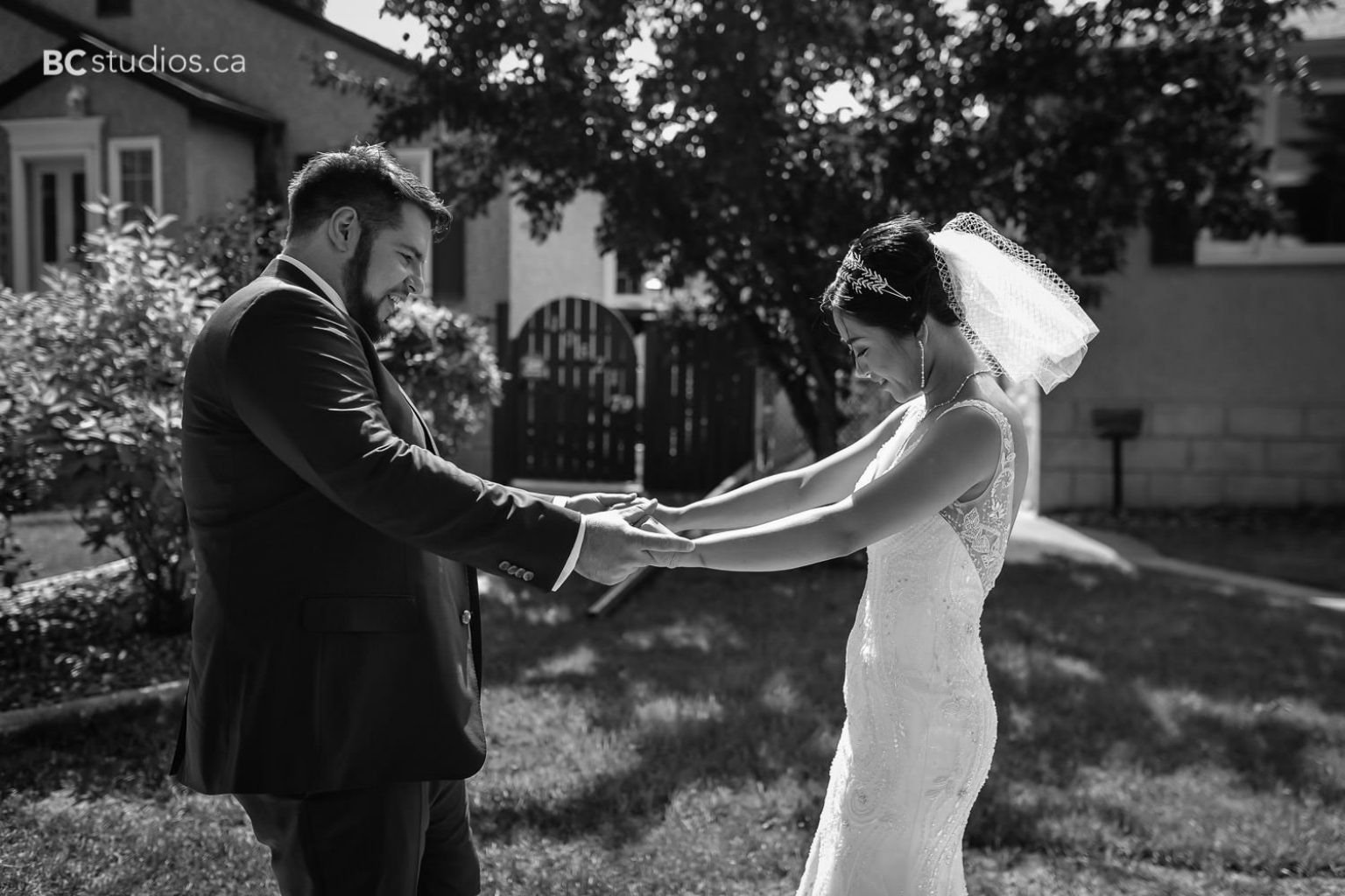 formal photos wedding at university of alberta. red brick wall. bride and groom. white dress.
