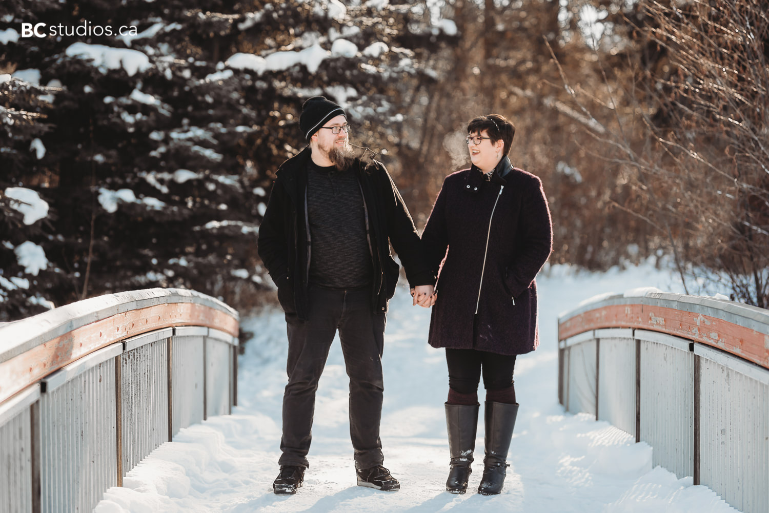 whitemud park engagement couple holding hands and walking photo