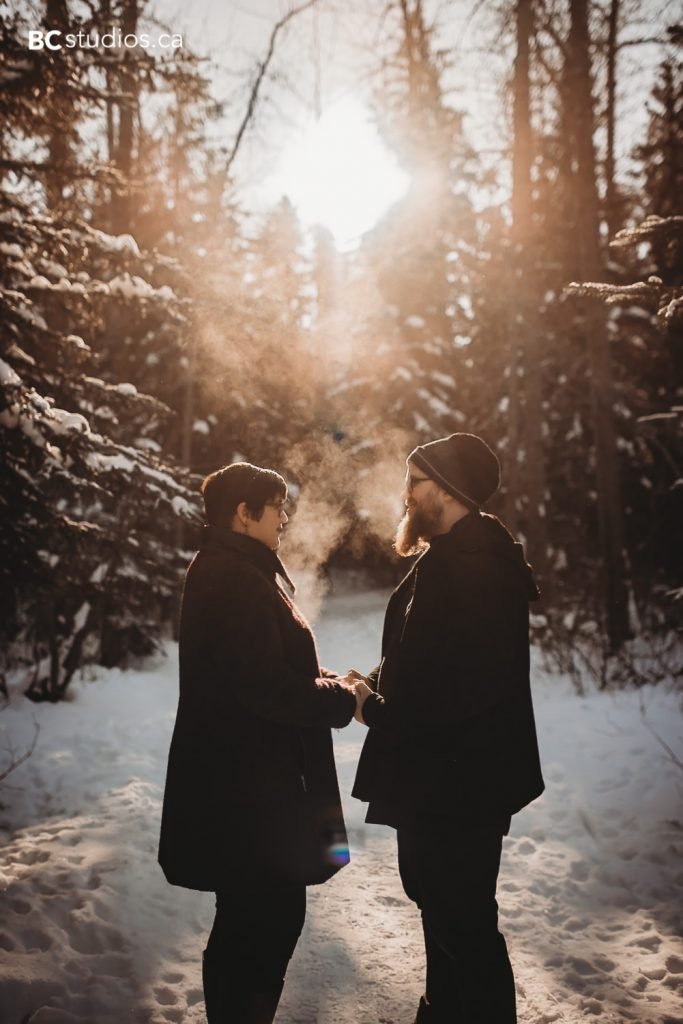 whitemud park engagement couple looking at each other sunset photo