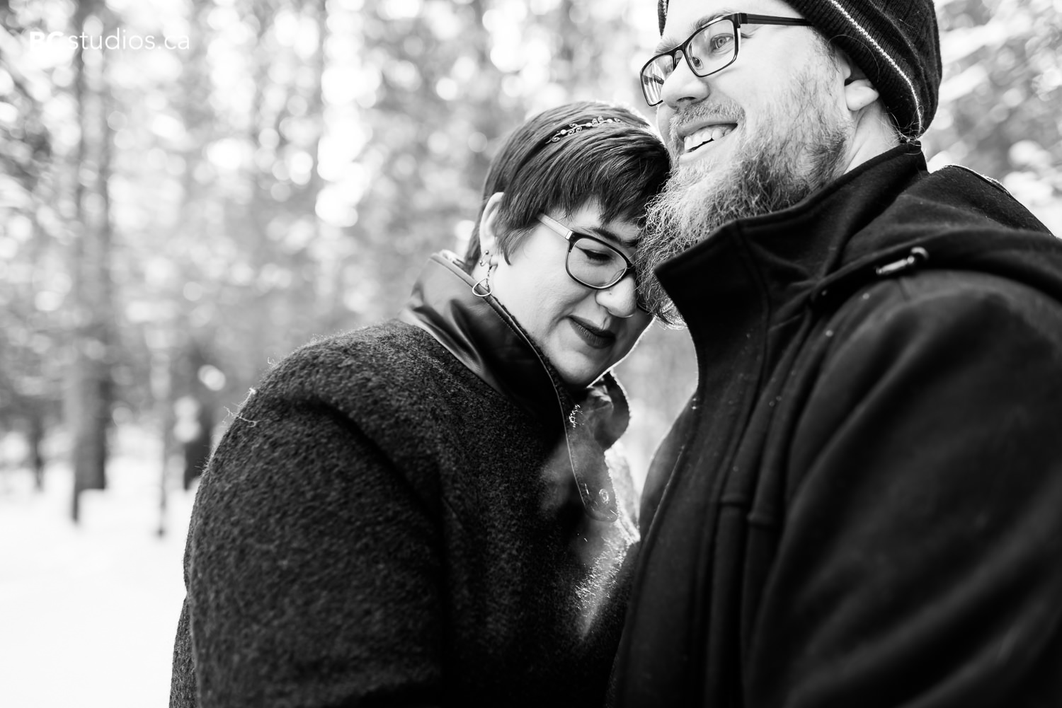 whitemud park engagement couple hugging black and white photo