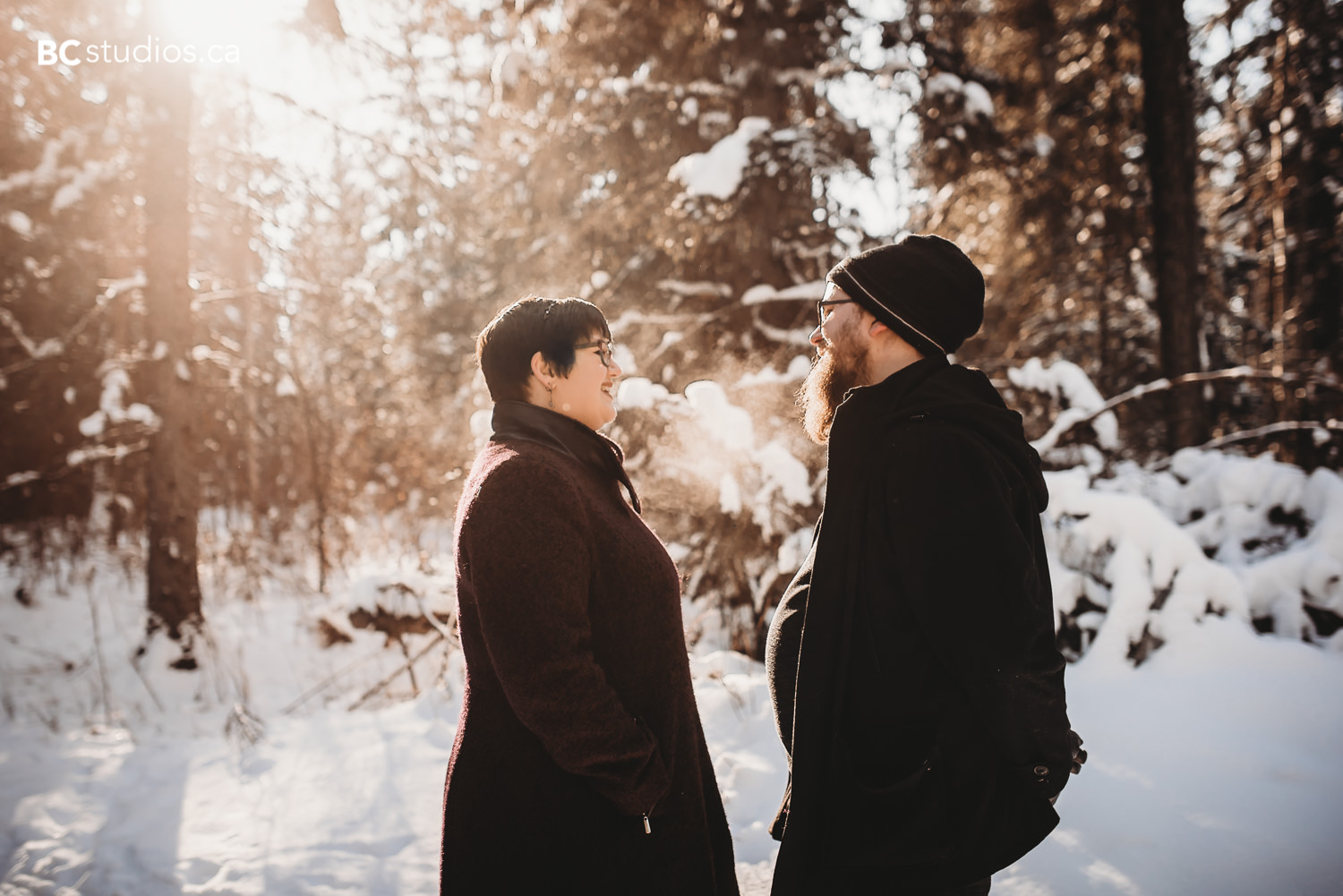 whitemud park engagement couple under sunlight photo