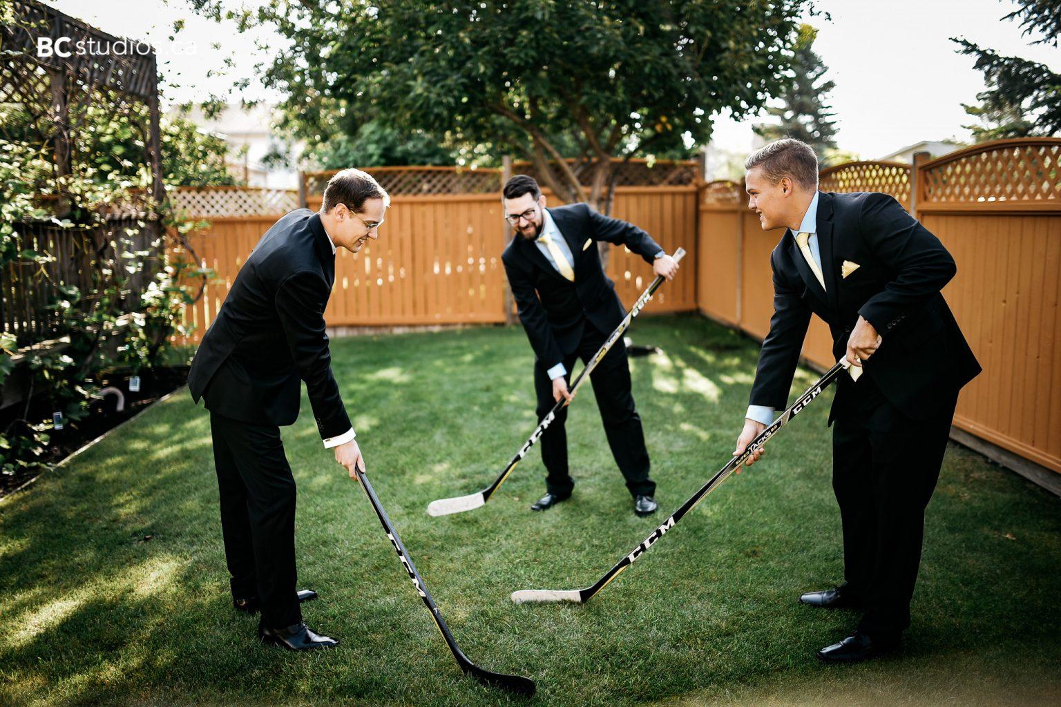 groom and groomsmen playing hockey - wedding photo
