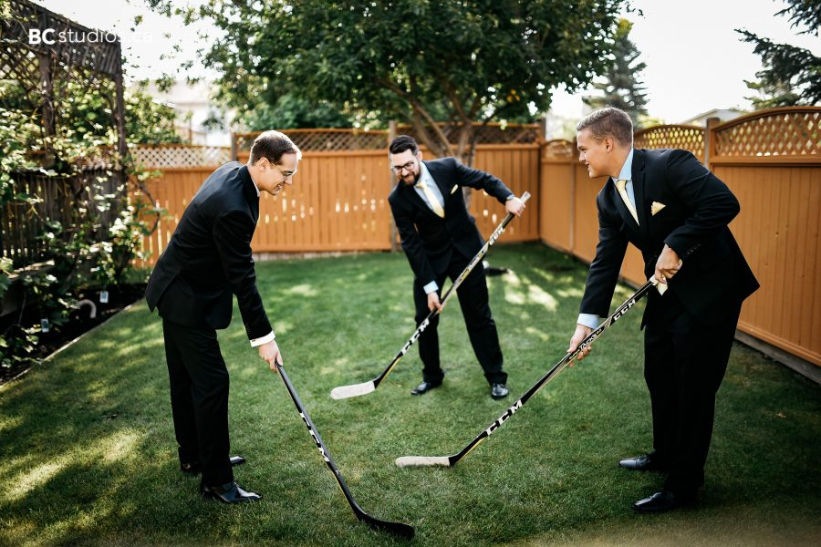 groom and groomsmen playing hockey - wedding photo